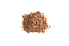 Pile cocoa powder isolated on white background Royalty Free Stock Photo