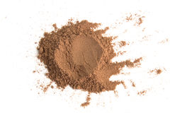 Pile cocoa powder isolated on white background Royalty Free Stock Photos