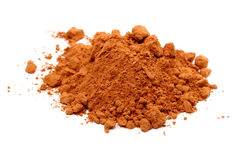 Pile of cocoa powder on white Stock Image