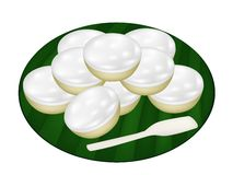 Pile of Coconut Puddings on Banana Leaf. Thai Traditional Dessert, A Stack of Kanom Thuay or Coconut Pudding Made From Coconut, Tapioca Flour, Pandan Leaves and Royalty Free Stock Photography