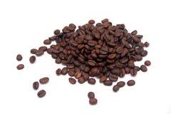Pile of coffee beans. Pile of coffee beans isolated on white Royalty Free Stock Image