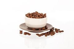 Pile of coffee beans on cup Stock Photos