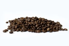 Pile of coffee beans isolated on white background royalty free stock photo