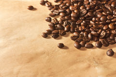 Pile of coffee beans on paper Royalty Free Stock Photos