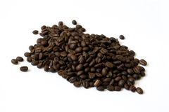 Pile of coffee beans on white background stock photo