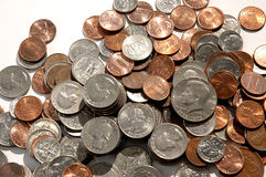 Pile of coins. Stacked pennies, nickels, quarters and dimes royalty free stock images