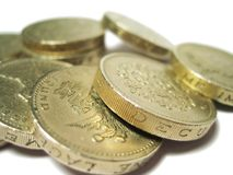 Pile of Coins. Pound coins (British) isolated against white backing, shallow depth of field royalty free stock photo