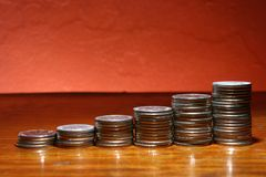 Pile of coins in ascending form Stock Photo