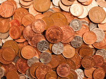 Pile of Coins. A pile of British coins consiting of coppers, five pences and twenty pences Stock Photos
