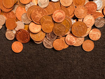 Pile of Coins. A pile of British coins consiting of coppers, five pences and twenty pences Royalty Free Stock Photos