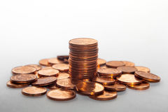 Pile of coins and a coin stack between it white background Stock Photo