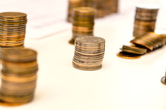 Pile of coins and counting Royalty Free Stock Images