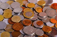 Pile of coins in different currencies Royalty Free Stock Images