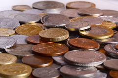Pile of coins in different currencies Royalty Free Stock Photos