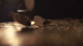 Pile of coins falling on the table stock video footage