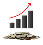 A pile of coins with graph and arrow Stock Photo