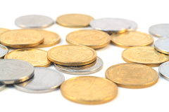 Pile of coins. Isolated on white Royalty Free Stock Images