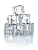 Pile of cold ice cubes. On white background Royalty Free Stock Photo