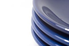 Pile of coloful plates isolate. D on white Royalty Free Stock Photo