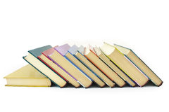 Pile of color books. Pile of color hardcover books over white background royalty free stock image