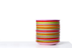The pile of color plates on a table Stock Photo