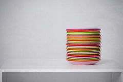 The pile of color plates on a table Stock Image