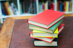 Pile of colored books on wooden desktop Royalty Free Stock Image