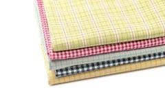 Pile of colored fabrics. Pile of colored fabrics,isolated on white background Royalty Free Stock Photos