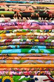 Pile of colored fabrics for sale at the market, Bologna, Italy. stock photo