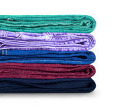 Pile of colored jeans on a white. Background Royalty Free Stock Image