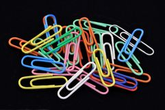 Pile of Colored Paperclips on Black Royalty Free Stock Image