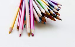 Pile of Colored Pencils. Big pile of different colored pencils on white background Stock Image