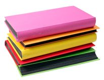 The pile of colored photo albums on wite backround Stock Photo