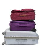 Pile of colored suitcases. Close up of pile of colored suitcases, isolated on white Royalty Free Stock Photos