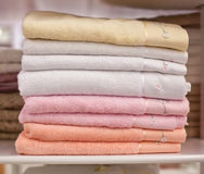 Pile colored of terry towels on the shelf Royalty Free Stock Image
