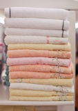 Pile colored of terry towels on the shelf Stock Images