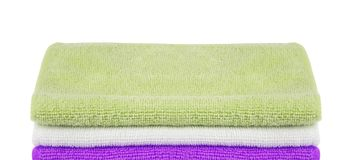 Pile of colored towels isolated royalty free stock photo
