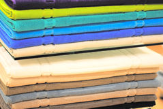 Pile of colored towels on the shelves. In a shop Royalty Free Stock Photo