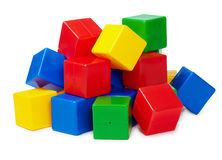 Pile of colored toy blocks on white Stock Images