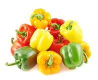 Pile of colorful bell peppers isolated Stock Photos