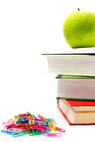 Pile of colorful books and apple on white background. Back to sc Royalty Free Stock Photo