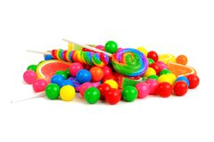 Pile of colorful candies against a white background. Pile of a variety of colorful candies against a white background Stock Image