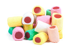 Pile of colorful candy sticks on white Stock Image