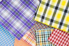 Plaid fabric. Pile of colorful checkered plaid fabric background texture Stock Photo
