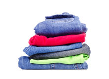 Pile of colorful children's clothing on a white Royalty Free Stock Photo