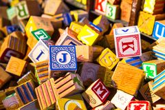 Pile of colorful children's vintage alphabet wooden block toys Royalty Free Stock Photography