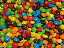 Lot of colorful chocolate drops. Pile of colorful chocolate drops like smarties royalty free stock photo
