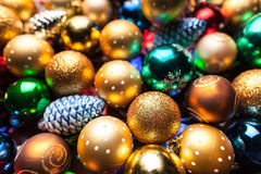 Pile of colorful Christmas balls. With blurred background stock image