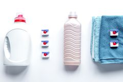 Pile of towels with detergent on white background top view Stock Photos