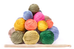 Pile of colorful clews for knitting and a needle Stock Images